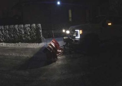 black-turck-night-snow-plow